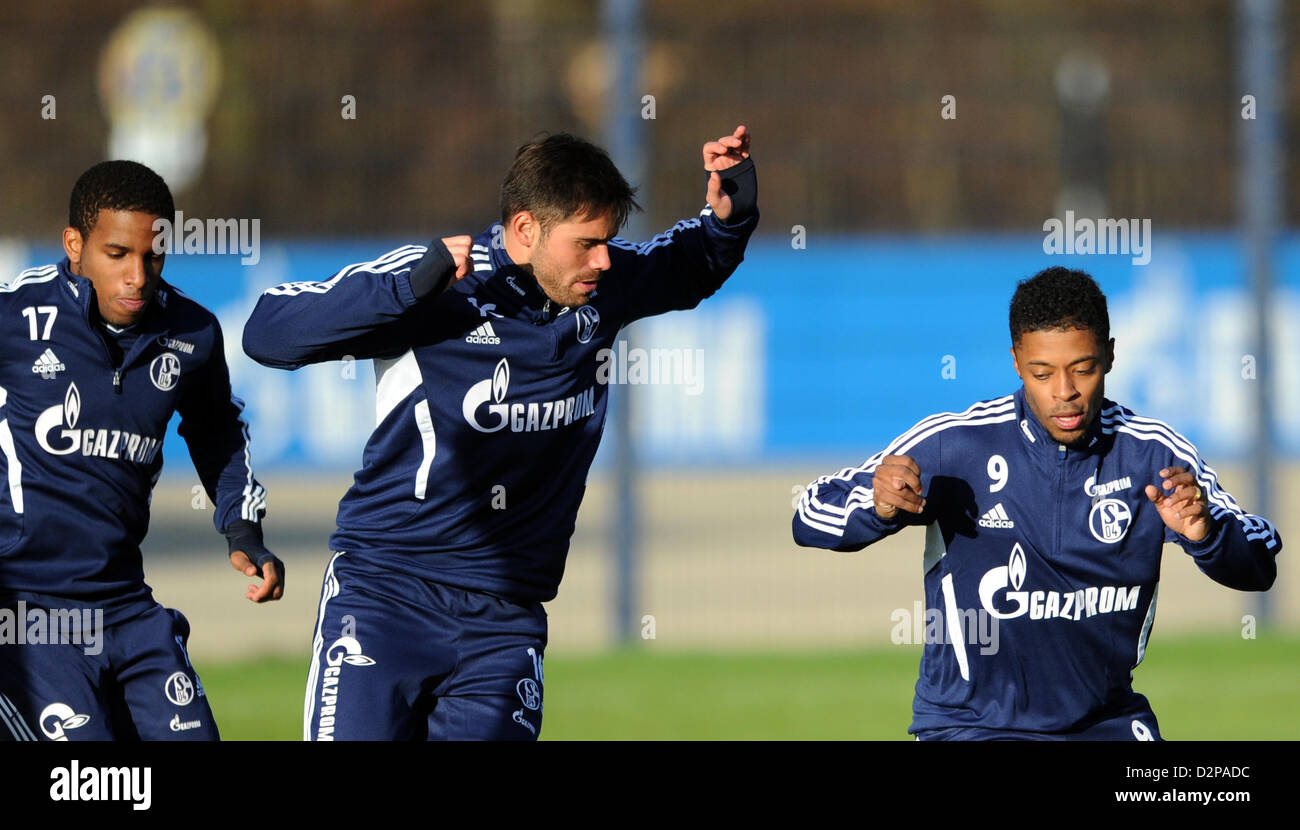 New acquisition of Bundesliga soccer club Schalke 04, Michael Bastos (R-L), Edu and Jefferson Farfan take part in - Stock Image