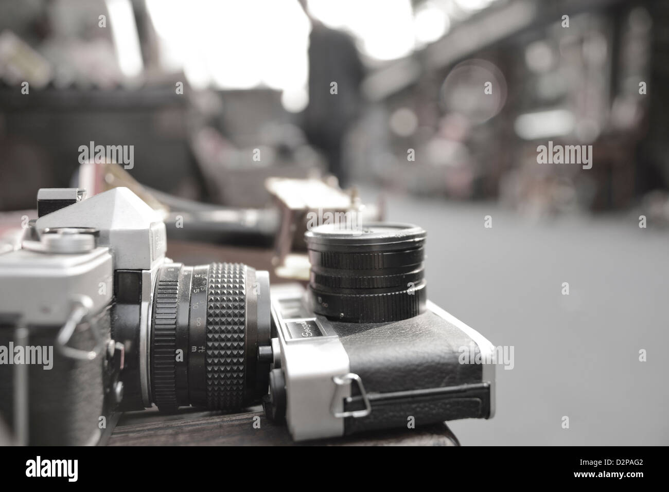 Old and classical cameras placed on top of table along the street side, Shanghai, China. - Stock Image