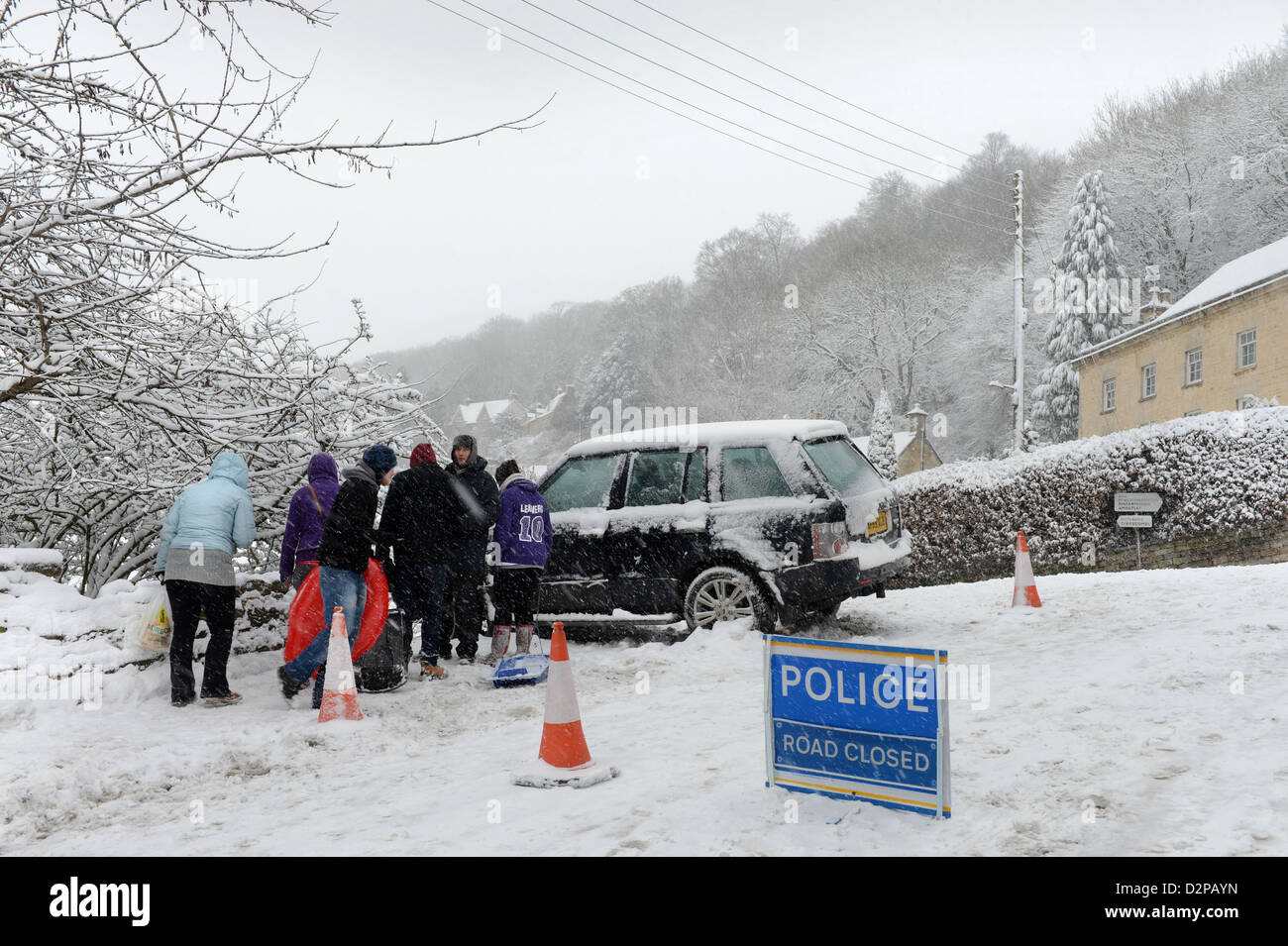 A Range Rover which hit a stationary Vauxhall after sliding in snow forcing it into gardens below on a hill known - Stock Image
