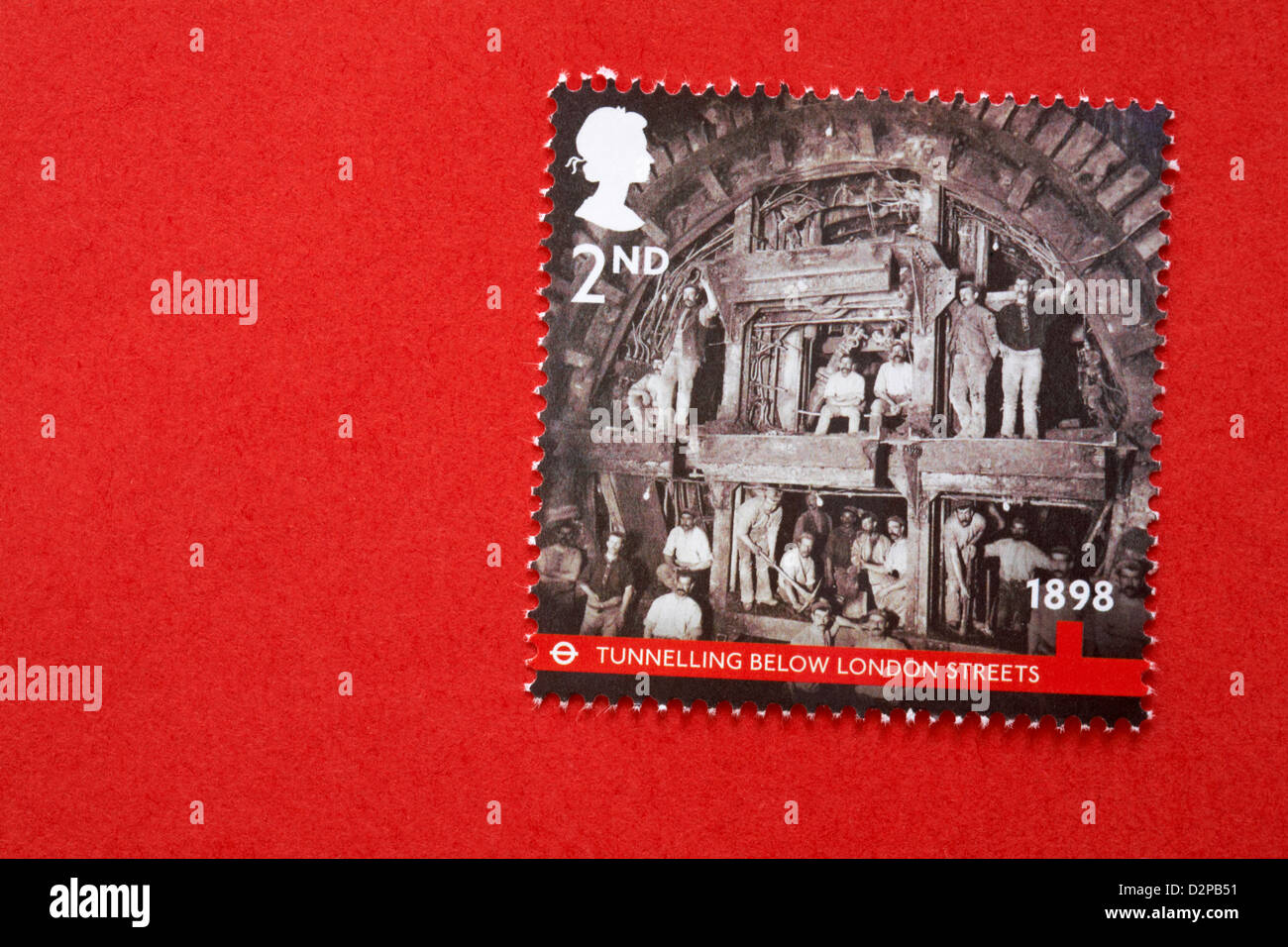 2nd class underground stamp on red envelope - Tunnelling below London streets 1898 - Stock Image