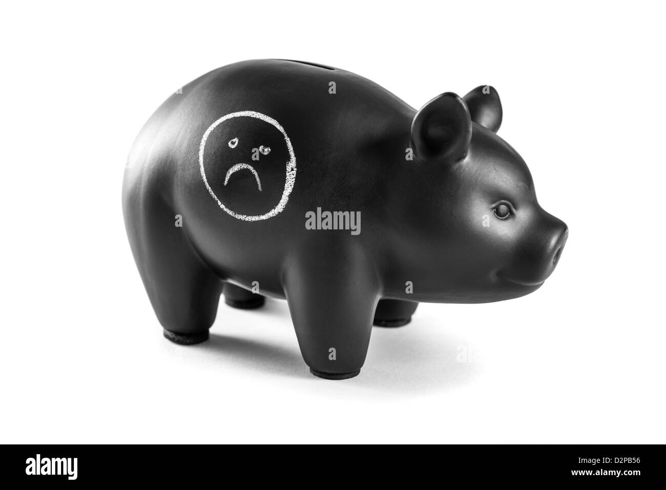 Black piggy bank on white background with sad face written on it - Stock Image