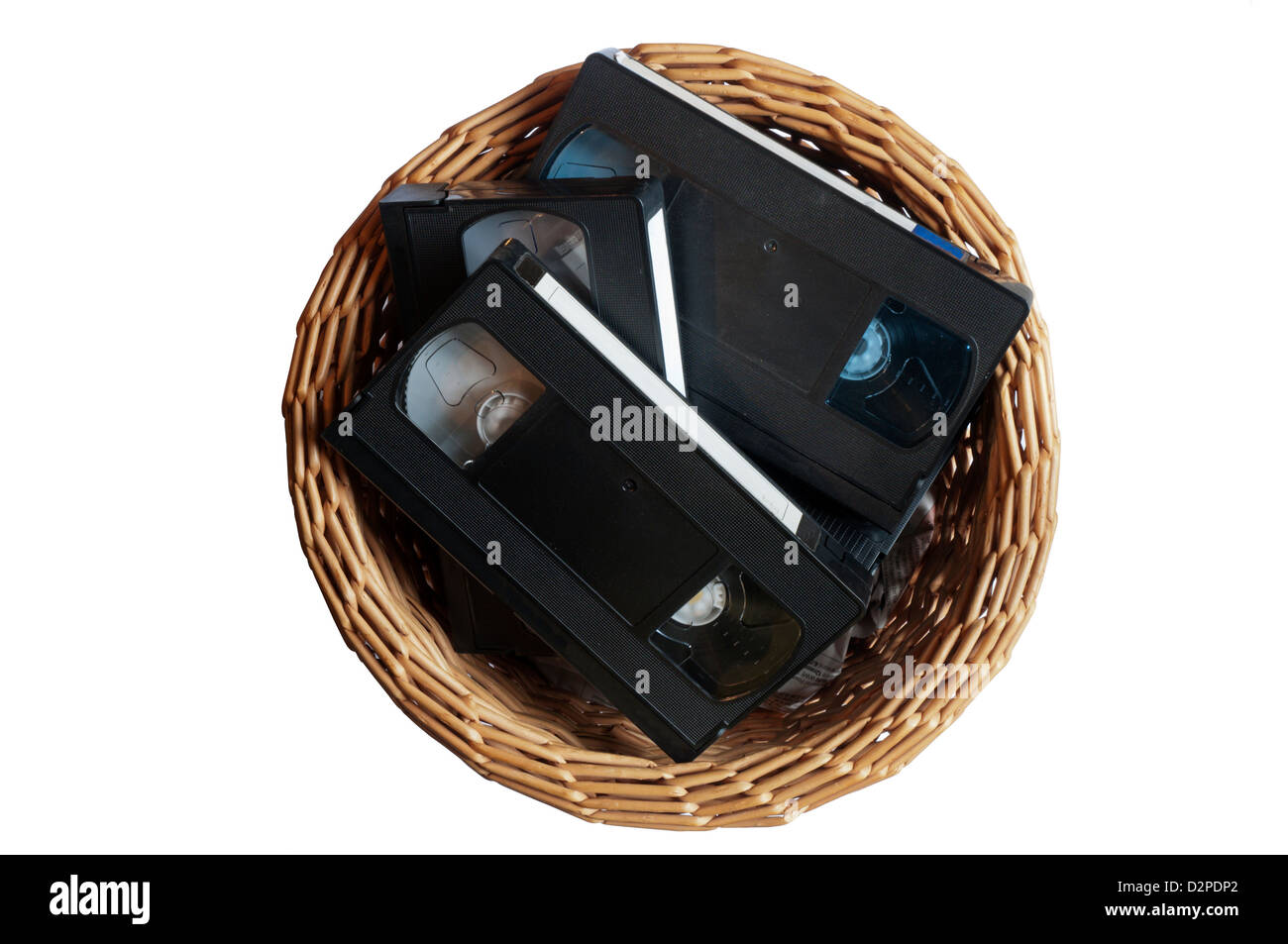 Video tape cassettes thrown away in a waste paper basket. - Stock Image