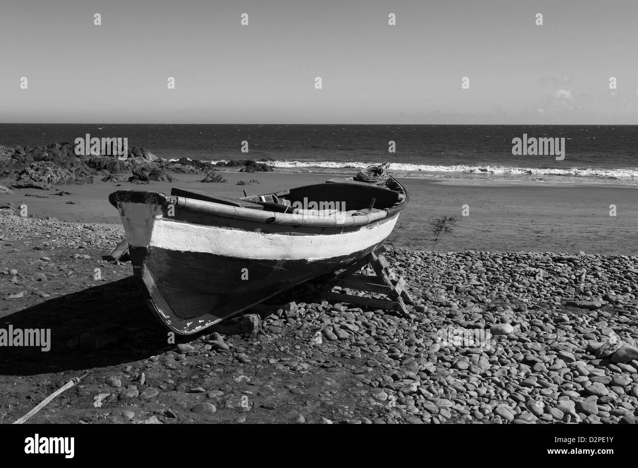 View of  old fishing boat, onto an oceanic beach, Gran Canaria, Canary Islands, Spain - Stock Image
