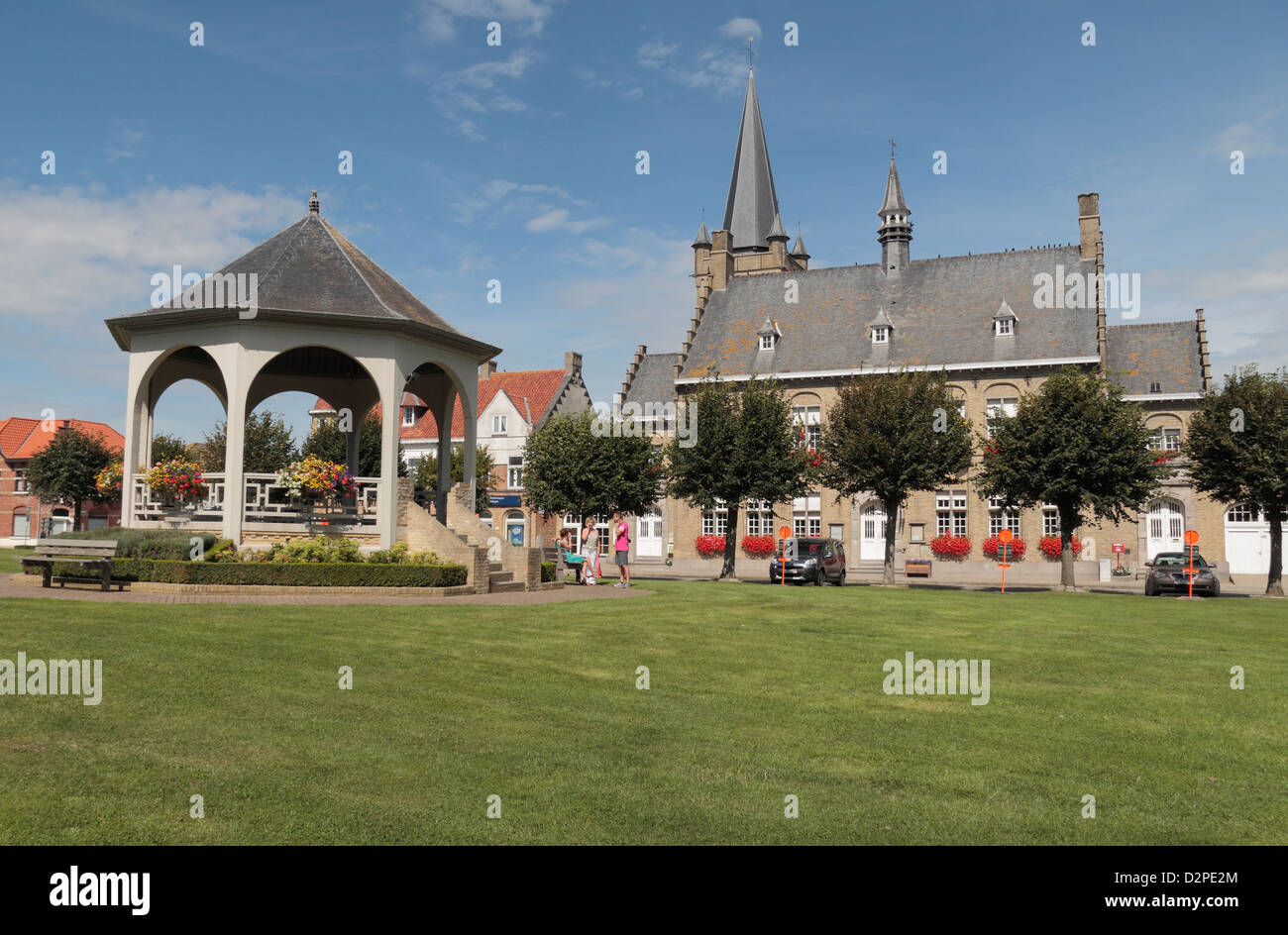 View through the village square past the bandstand in Wijtschate town centre, West Flanders Heuvelland, Belgium.. - Stock Image