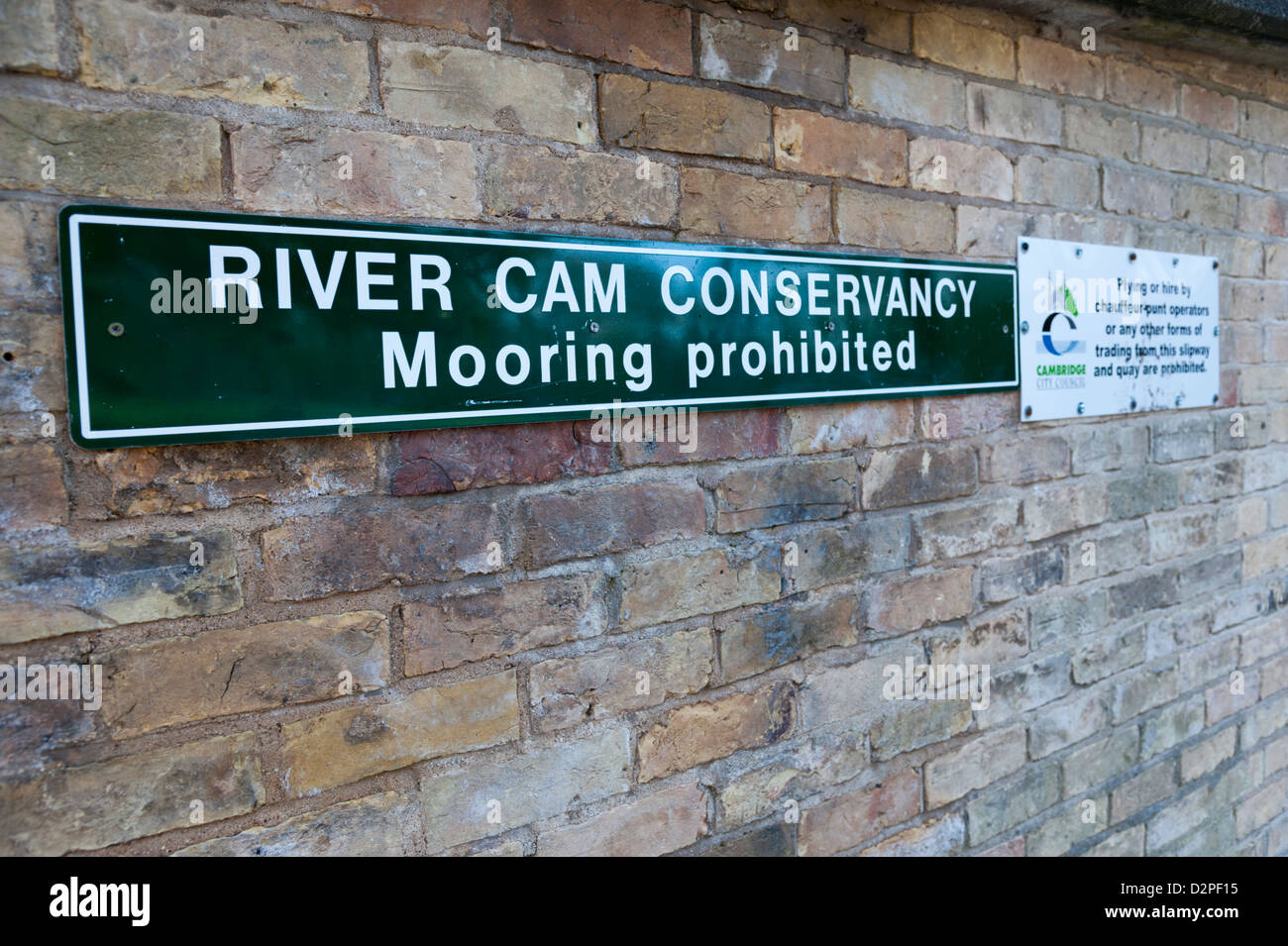 Sign by City Council advising no mooring or plying for hire by punt chauffeurs Garrett Hostel Lane Cambridge UK - Stock Image
