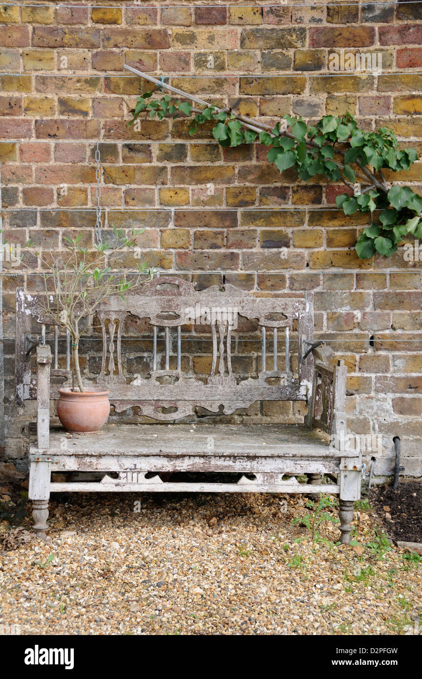 Terrific Old Wooden Garden Bench In Front Of Brick Wall Stock Photo Caraccident5 Cool Chair Designs And Ideas Caraccident5Info