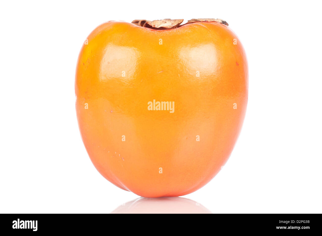 Persimmon over white reflective background. - Stock Image