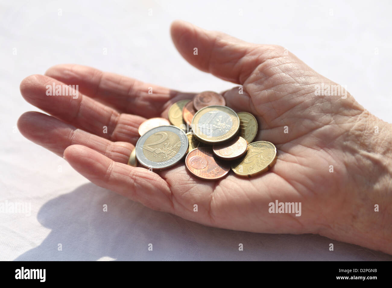 Berlin, Germany, Euromuenzen are in the hands of a pensioner - Stock Image