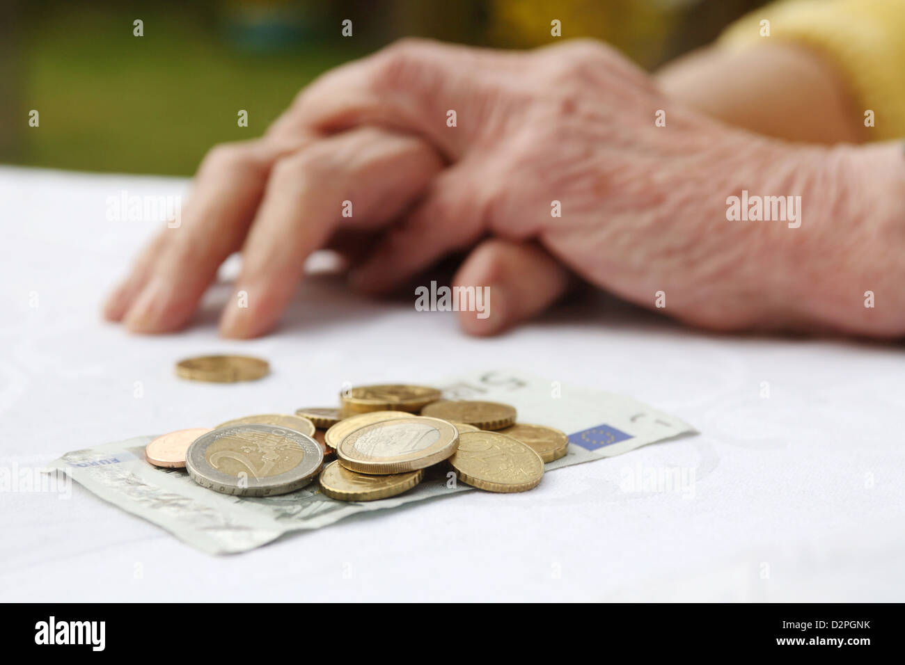 Berlin, Germany, in addition to the hands of a pensioner is money on the table - Stock Image