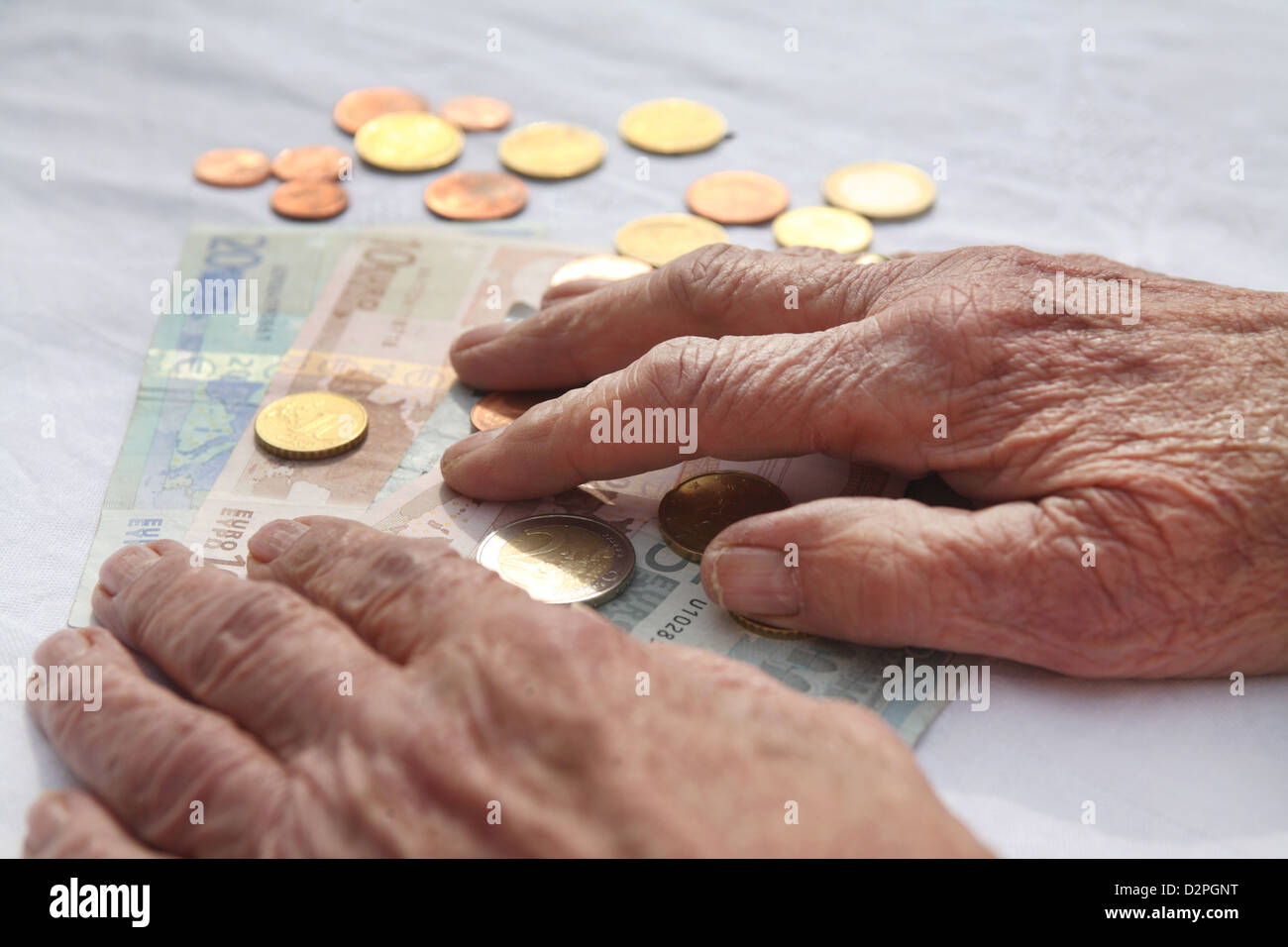 Berlin, Germany, the hands are a pensioner on money - Stock Image