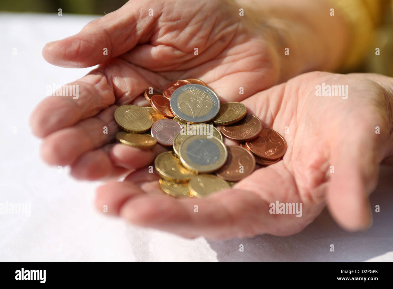 Berlin, Germany, Euromuenzen lie in the hands of a pensioner - Stock Image
