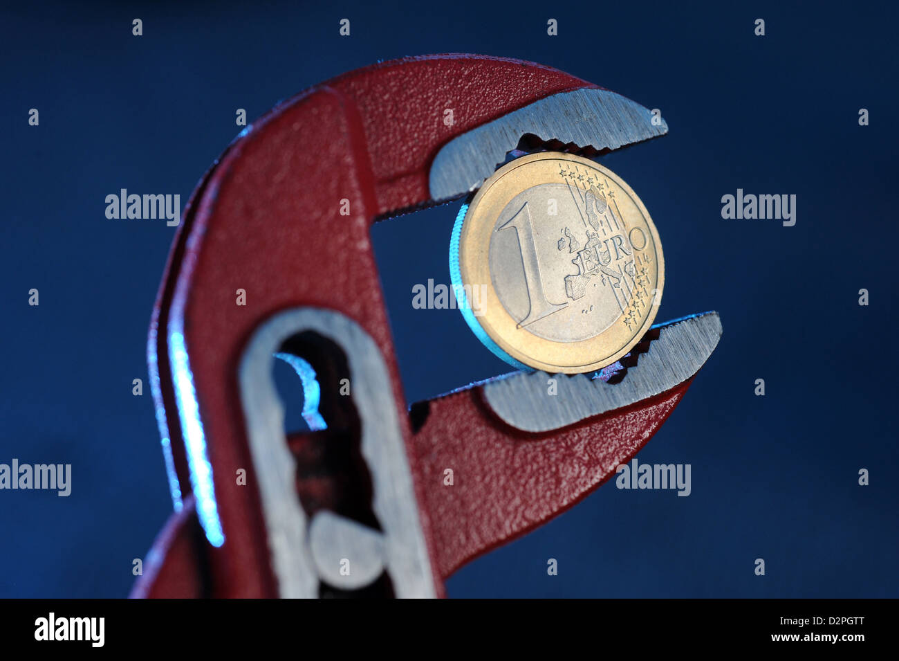 Berlin, Germany, a euro in the forceps - Stock Image