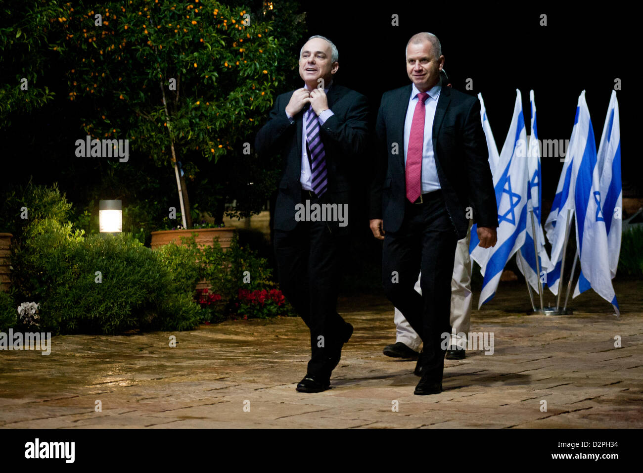 Incumbent Minister of Finance in outgoing government, Yuval Steinitz (L), representing Likud-Beitenu, is escorted - Stock Image