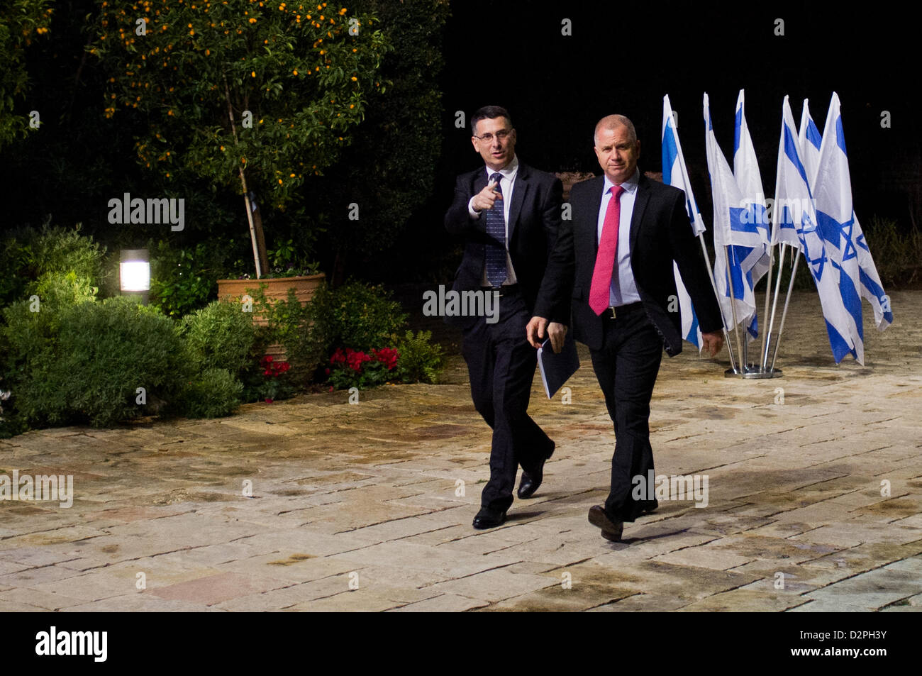 Incumbent Minister of Education in outgoing government, Gideon Saar (L), representing Likud-Beitenu, is escorted - Stock Image