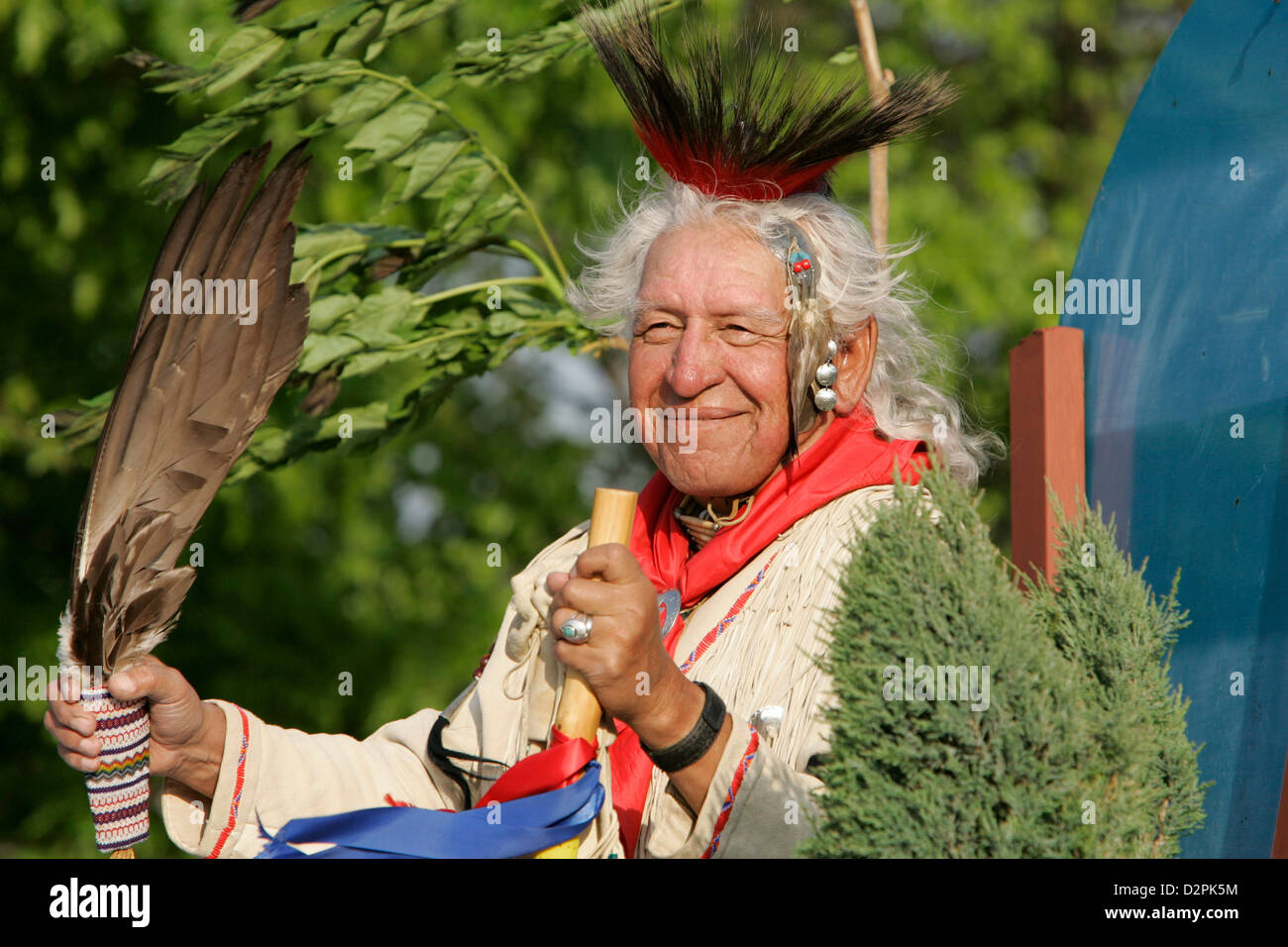 An American Indian Chief smiles in the sun - Stock Image