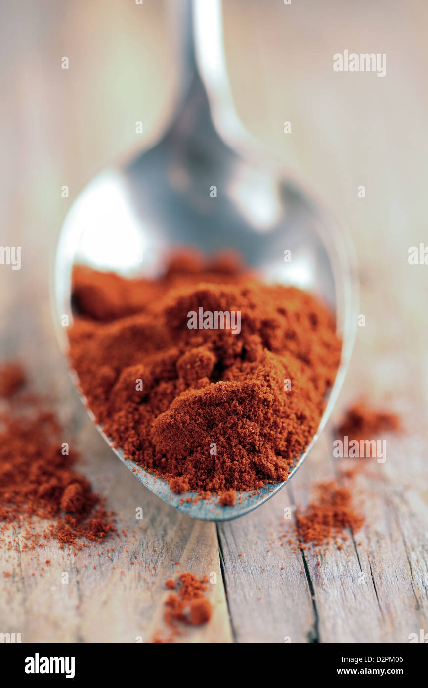 Spoon of paprika spice - Stock Image
