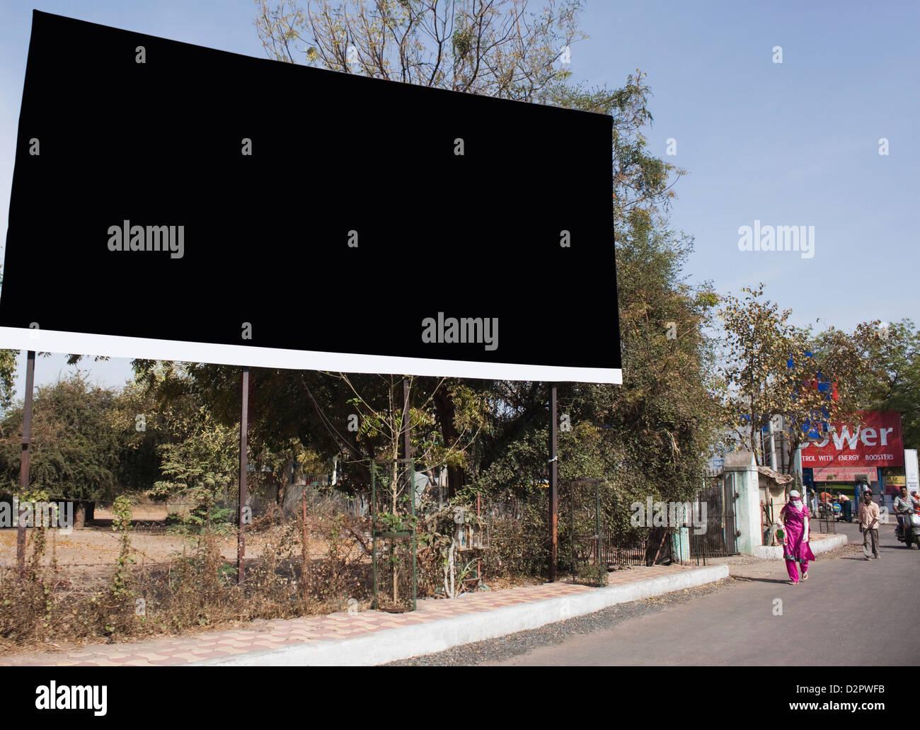 Billboard on the roadside, Ahmedabad, Gujarat, India - Stock Image