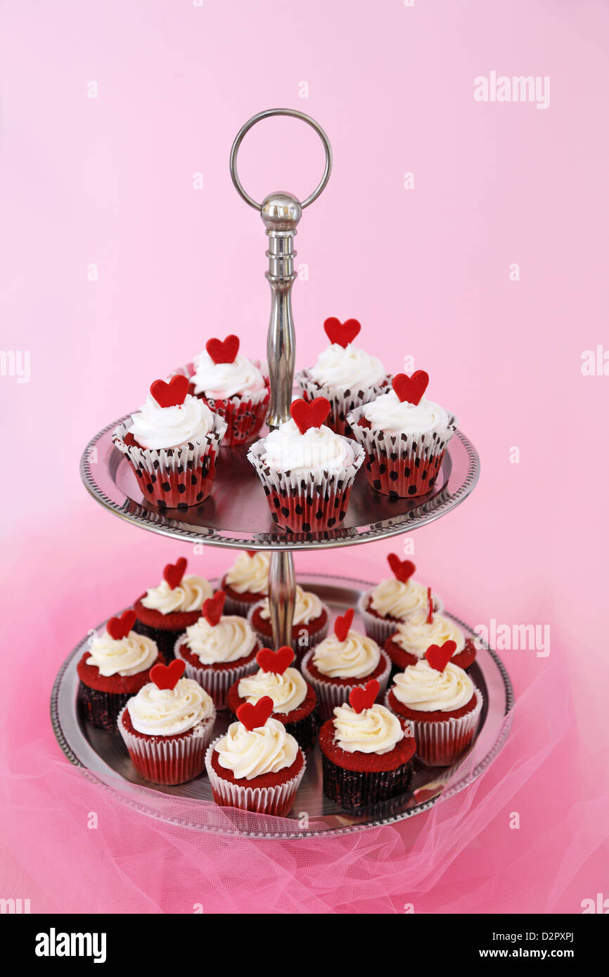 Red Velvet Cupcakes With Cream Cheese On A Two Tier Cake Stand Stock