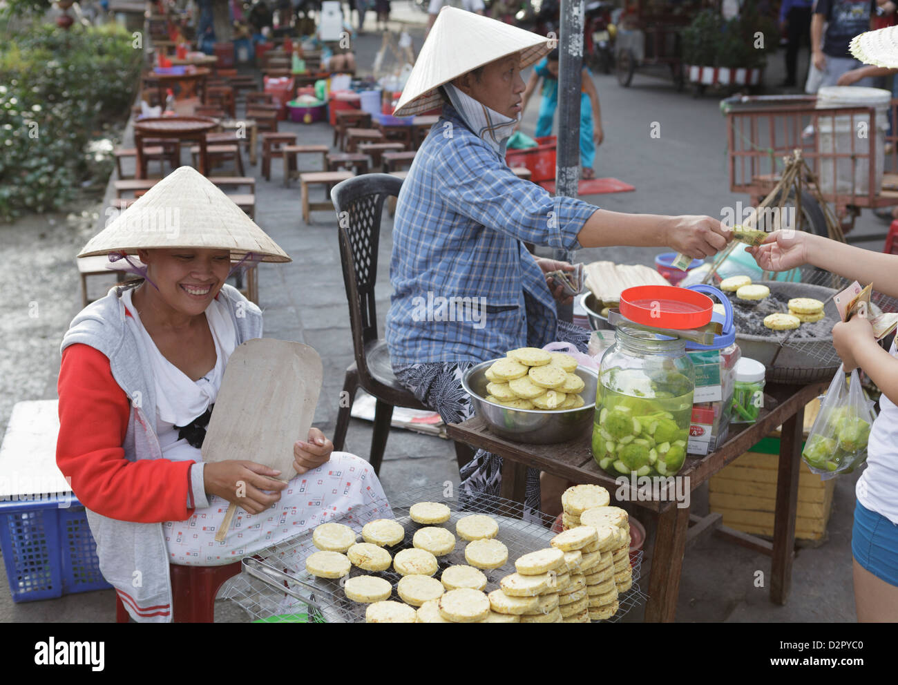 Women sell hot potato snacks in the Ancient Town, Hoi An, Vietnam, Indochina, Southeast Asia, Asia - Stock Image