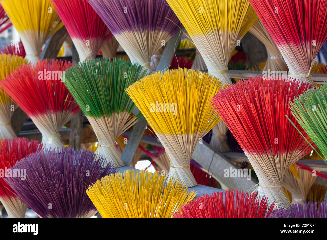 Bundles of incense sticks for sale, made by traditional craftsmen from Thuy Zuan Hat village, Hue, Vietnam, Indochina - Stock Image