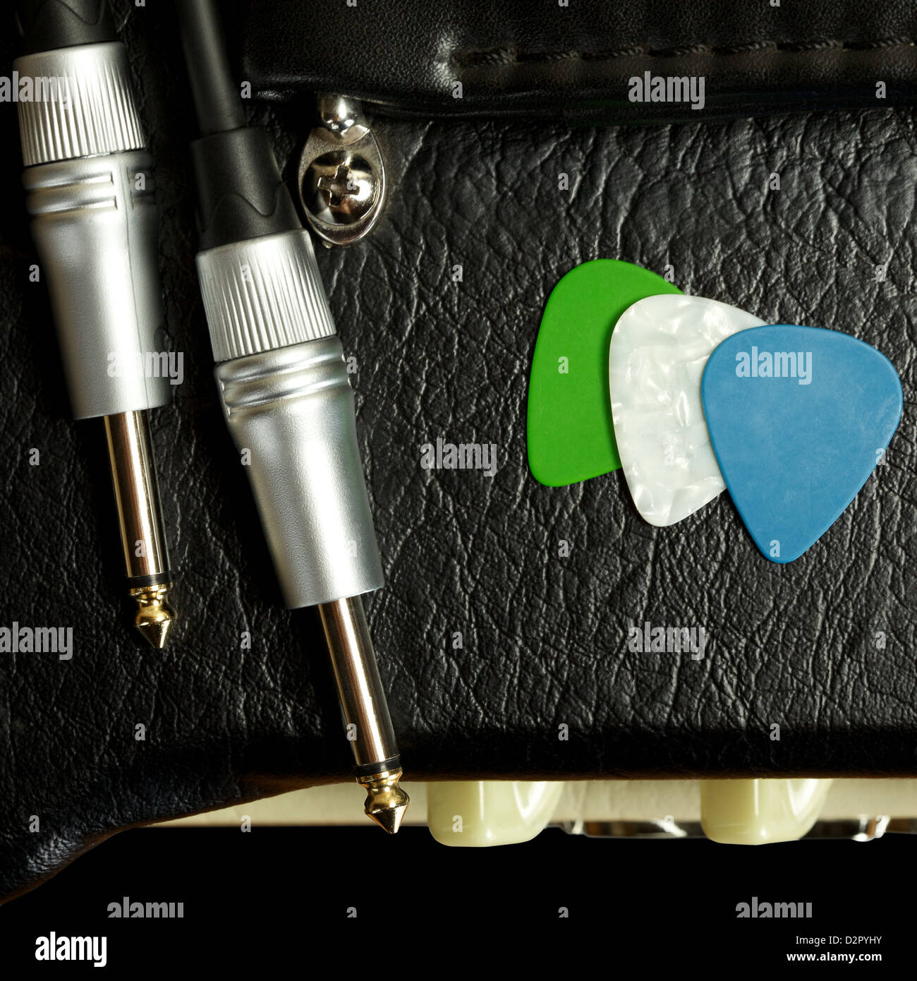 guitar amplifier with cable jack and plectrums, closeup Stock Photo