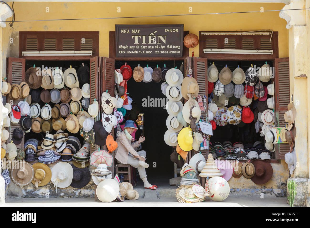A hat seller's shop front, Hoi An Old Town, Hoi An, Vietnam, Indochina, Southeast Asia, Asia - Stock Image