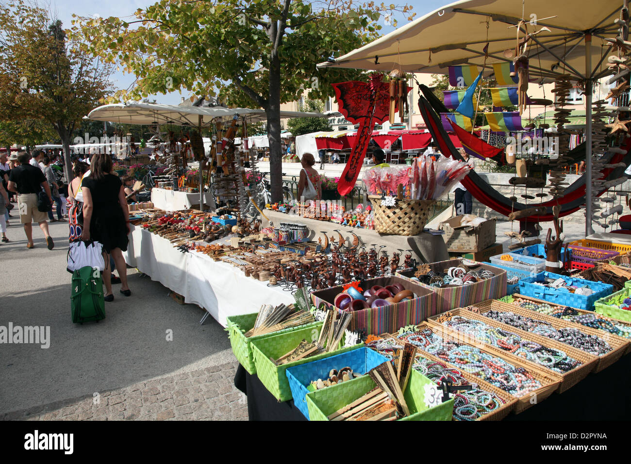 Stalls in the street market held every Sunday in Ile sur la Sorgue, Provence, France, Europe - Stock Image
