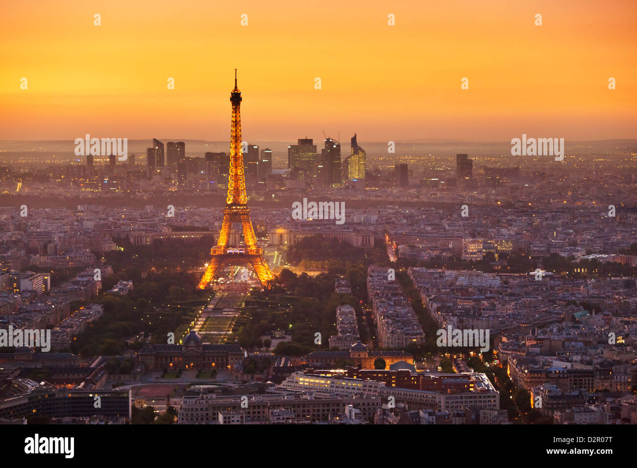 Paris skyline at sunset with the Eiffel Tower and La Defense, Paris, France, Europe - Stock Image