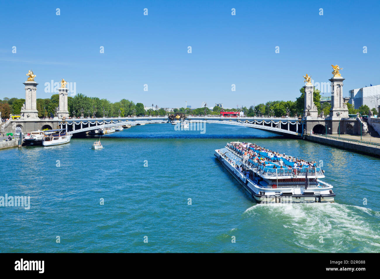 River Seine Cruise boat, Bateaux Mouches and the Pont Alexandre III Bridge, Paris, France, Europe - Stock Image