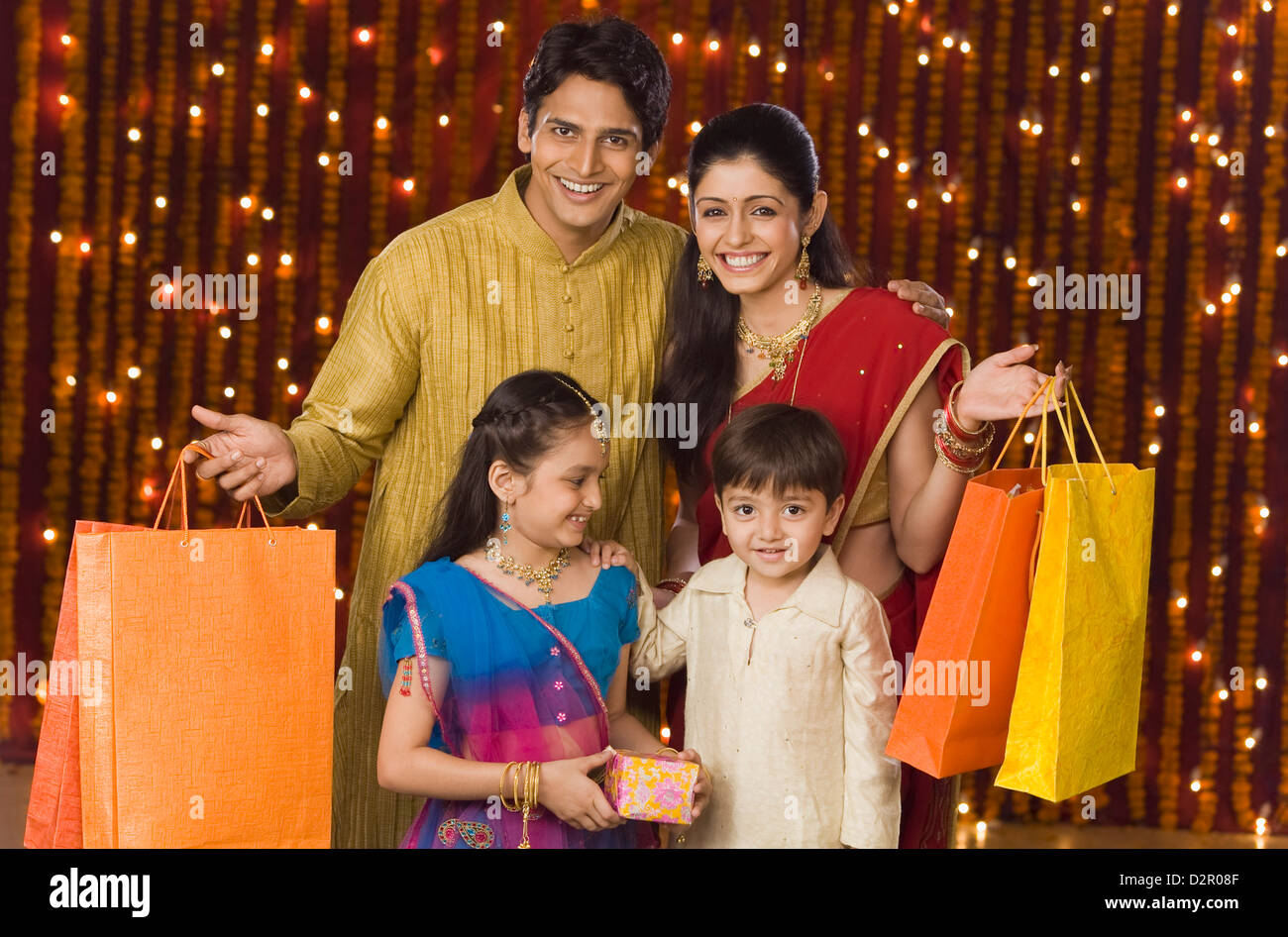Portrait of a family with shopping bags and Diwali gift Stock Photo ... for Diwali Gifts For Family  585hul