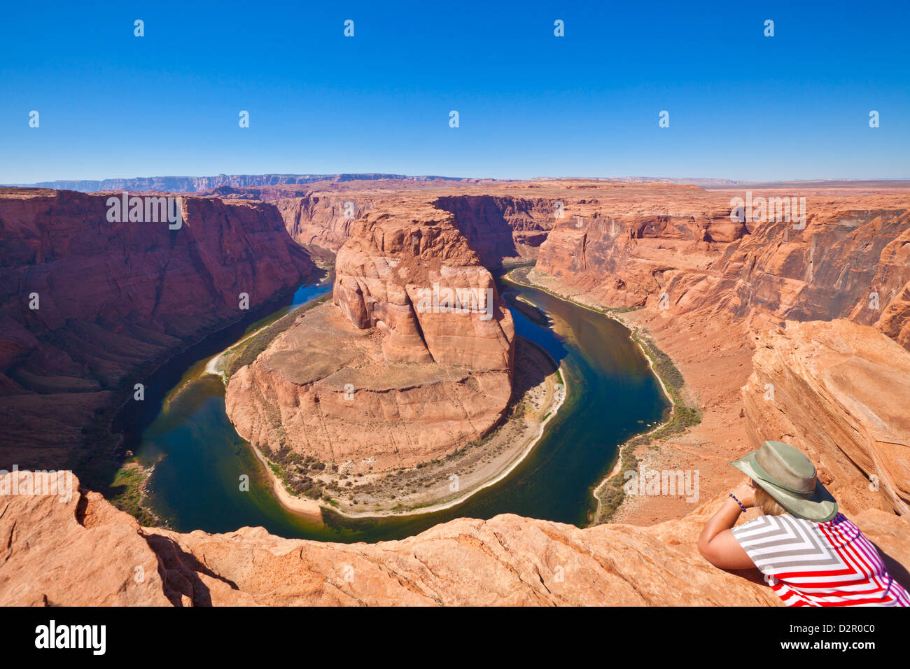 Tourist overlooking Horseshoe Bend on the Colorado River, Page, Arizona, United States of America, North America - Stock Image