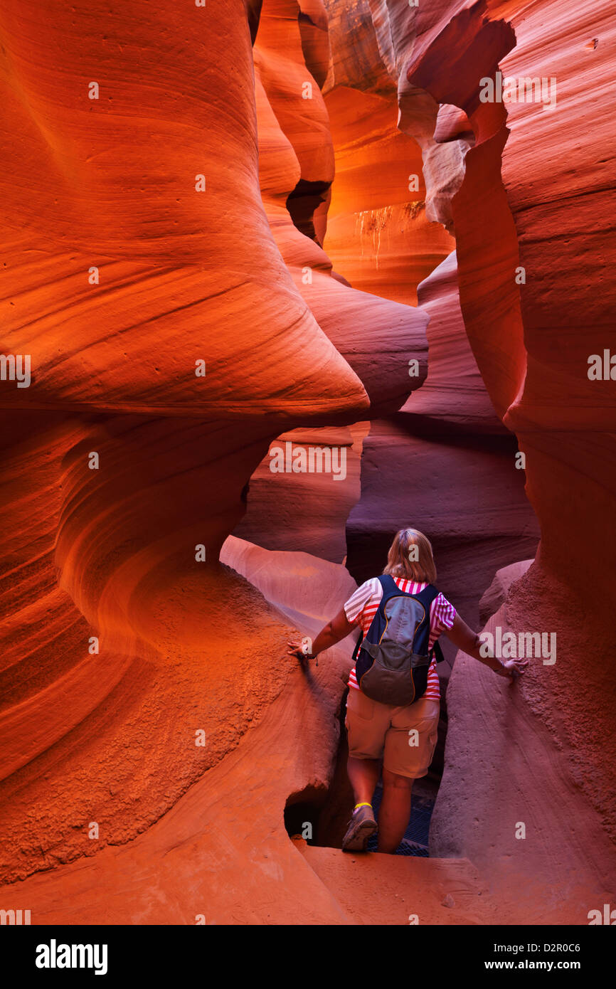 Female tourist hiker and Sandstone Rock formations, Lower Antelope Canyon, Page, Arizona, USA - Stock Image