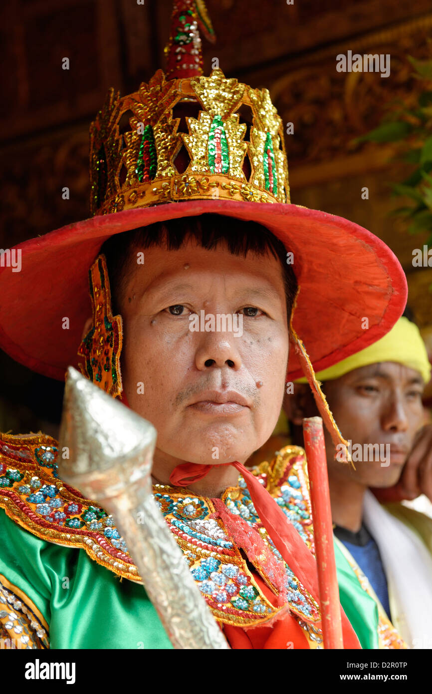 A guard, the queens and the ministers at the biggest Nat ritual in Taungbyon, Mandalay Division, Burma, Myanmar - Stock Image