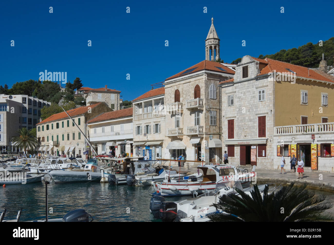 Promenade cafes by the old harbour in the medieval city of Hvar, on the island of Hvar, Dalmatia, Croatia, Europe - Stock Image