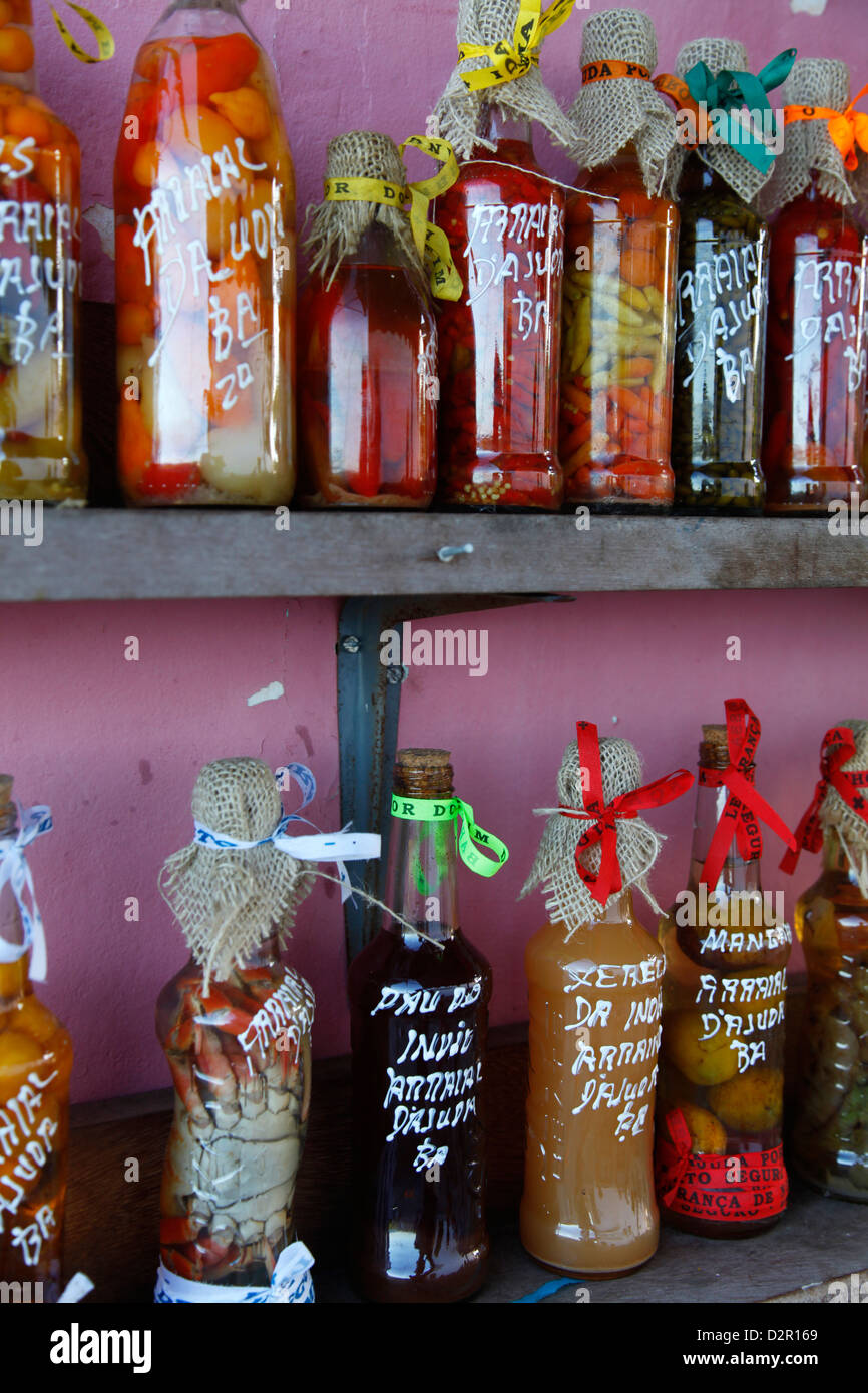 Colourful preserved fruits vegetables and chilli peppers souvenirs, Arraial d'Ajuda, Bahia, Brazil, South America - Stock Image