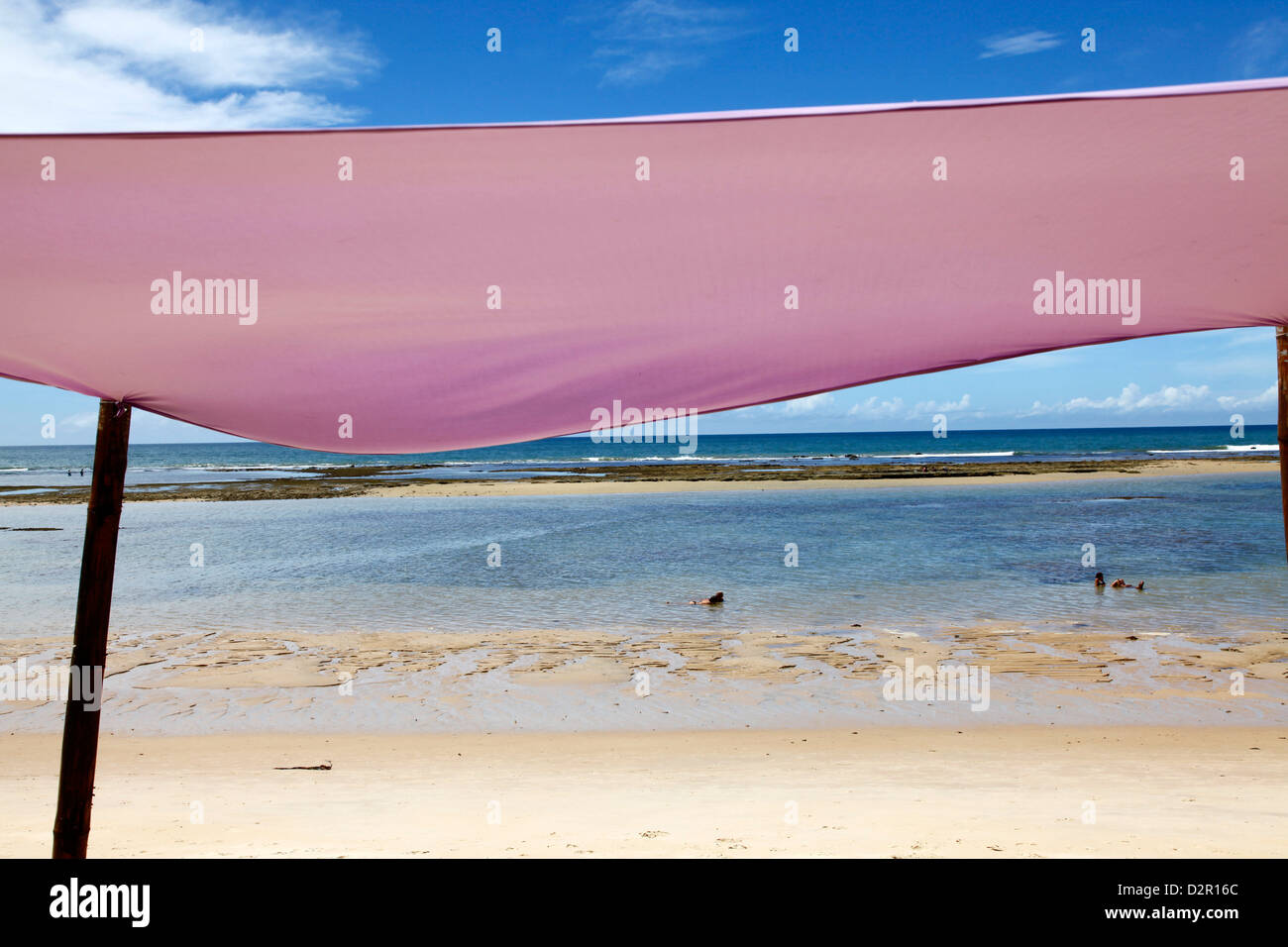 People swimming at Parracho Beach, Arraial d'Ajuda, Bahia, Brazil, South America - Stock Image