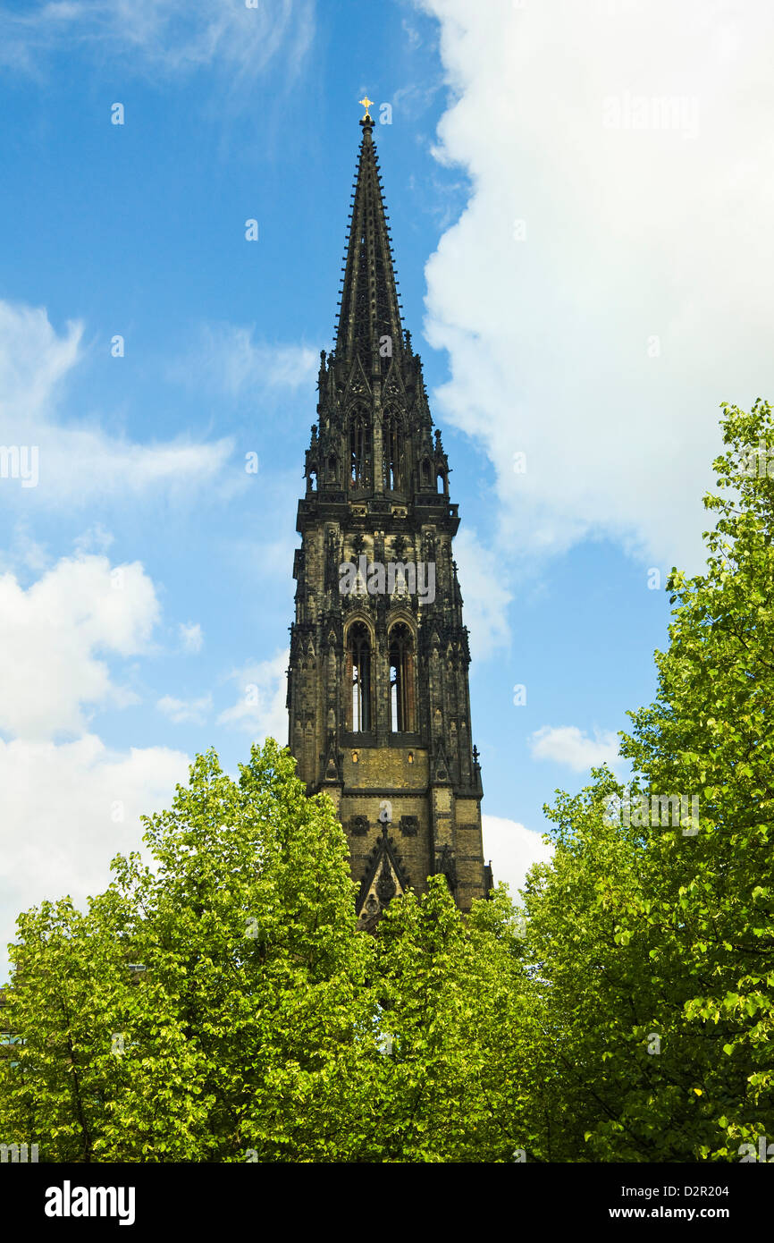 Spire of St. Nicholas Church, a marker for WWII bombers that devastated the city, now a war memorial, Hamburg, Germany - Stock Image