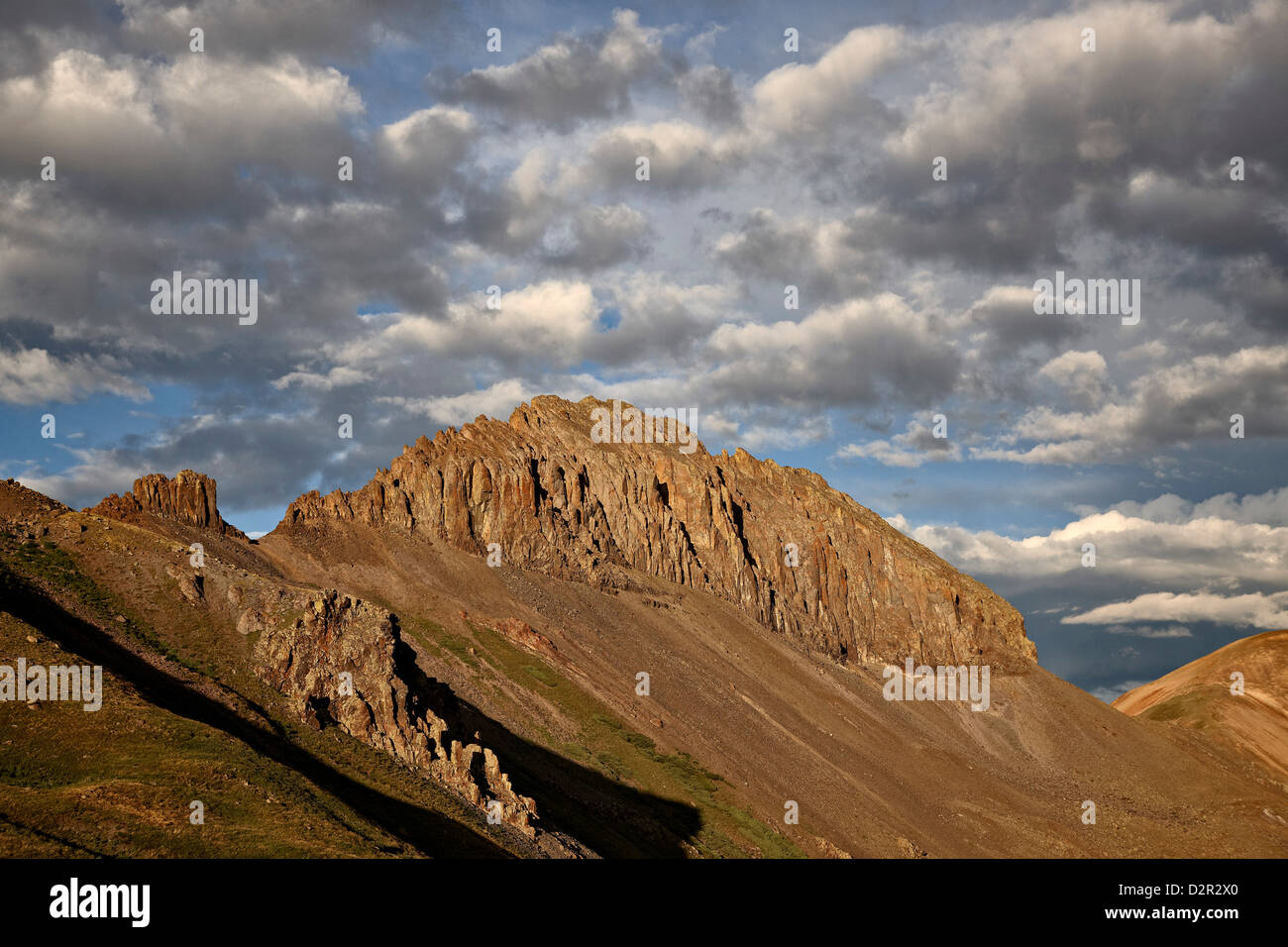 Jagged ridge with puffy clouds, Rio Grande National Forest, Colorado, United States of America, North America - Stock Image