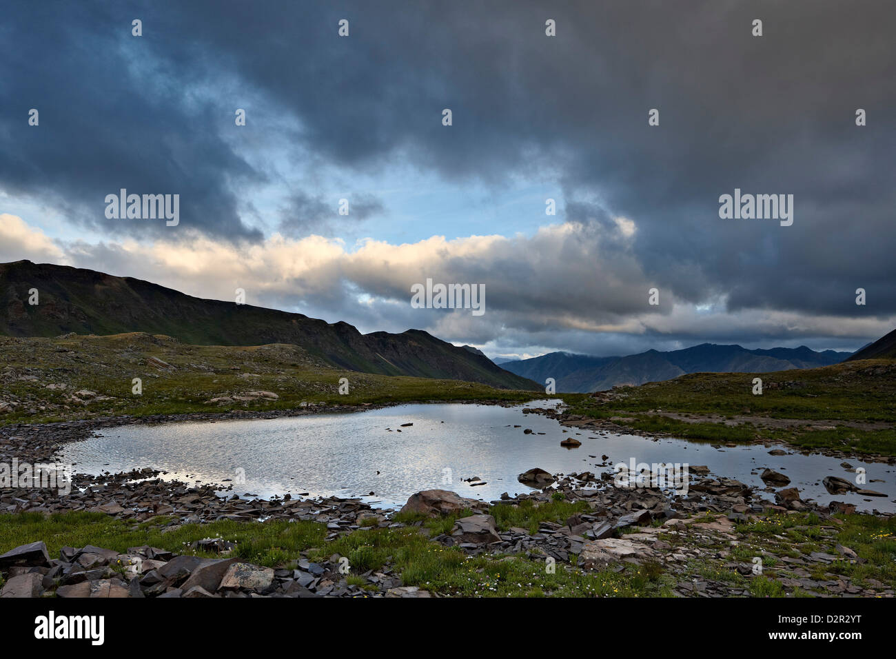 Cloudy sky above an Alpine tarn, San Juan National Forest, Colorado, United States of America, North America - Stock Image