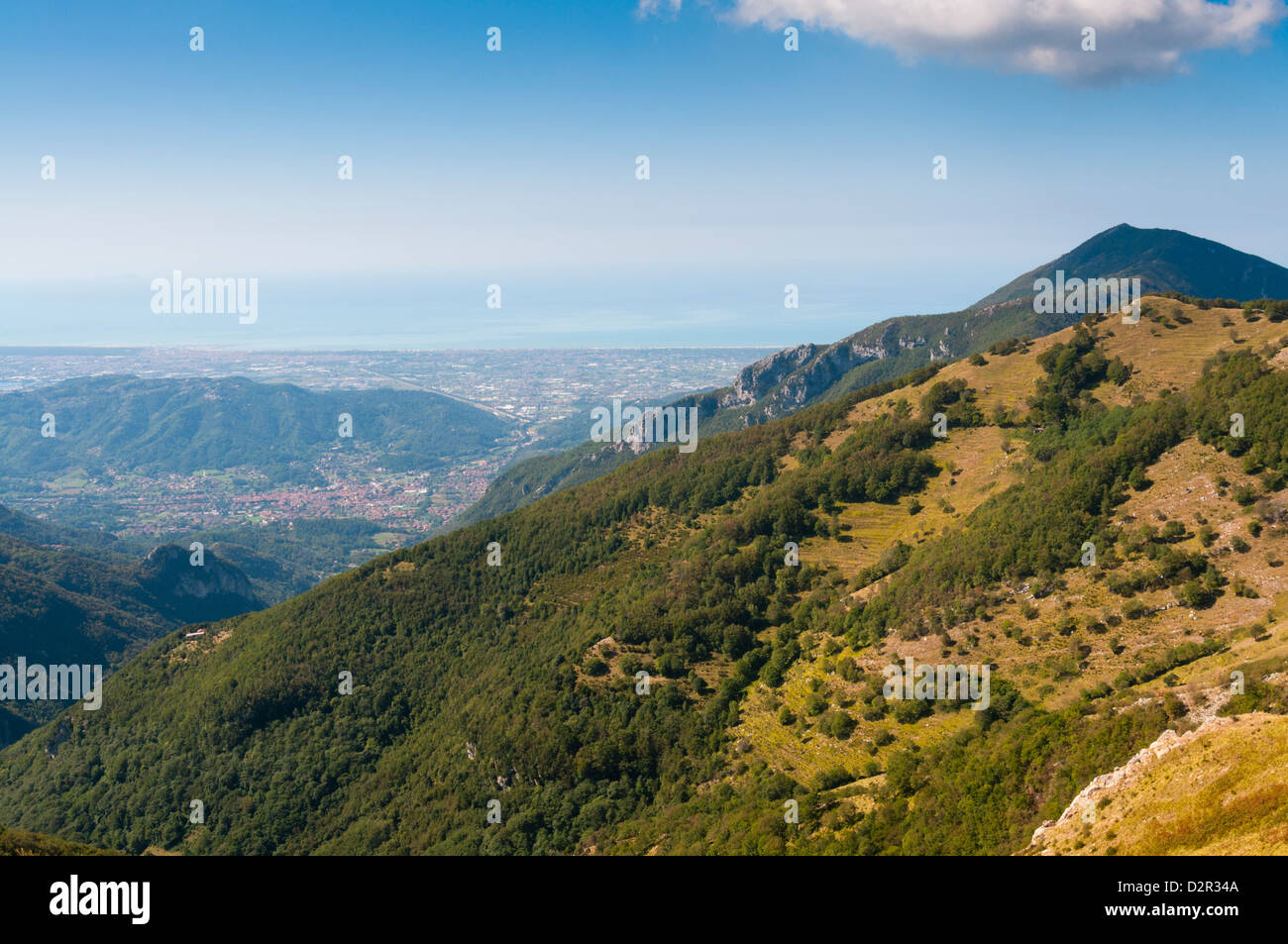 View of Camaiore and Tyrrhenian Sea from Apuan Alps (Alpi Apuane), Lucca Province, Tuscany, Italy, Europe - Stock Image