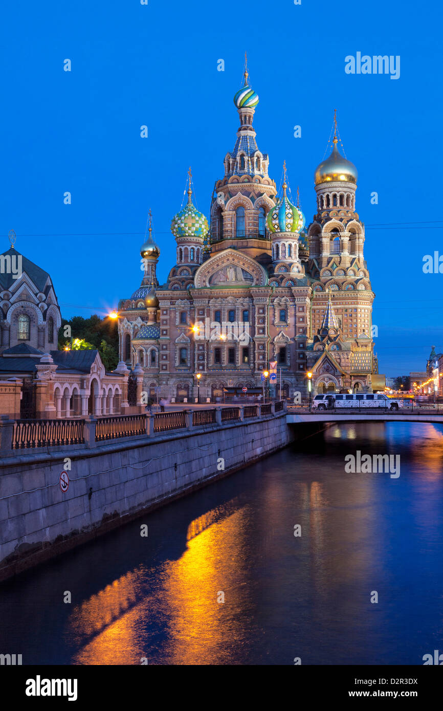 The Church on Spilled Blood, on the Kanal Griboedova, illuminated at dusk, St. Petersburg, Russia - Stock Image