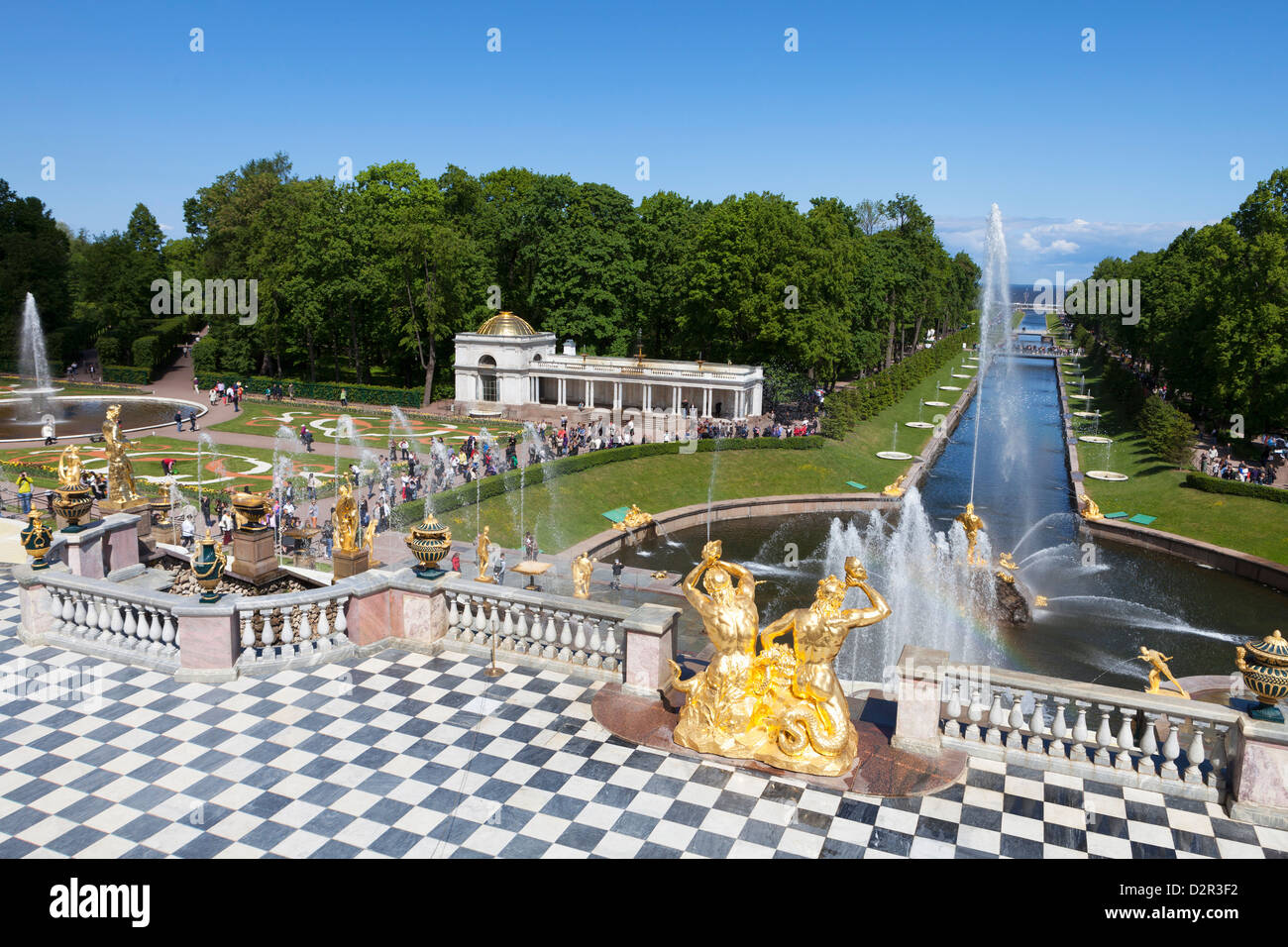 Golden statues and fountains of the Grand Cascade at Peterhof Palace with the Marine Canal, St. Petersburg, Russia, Stock Photo