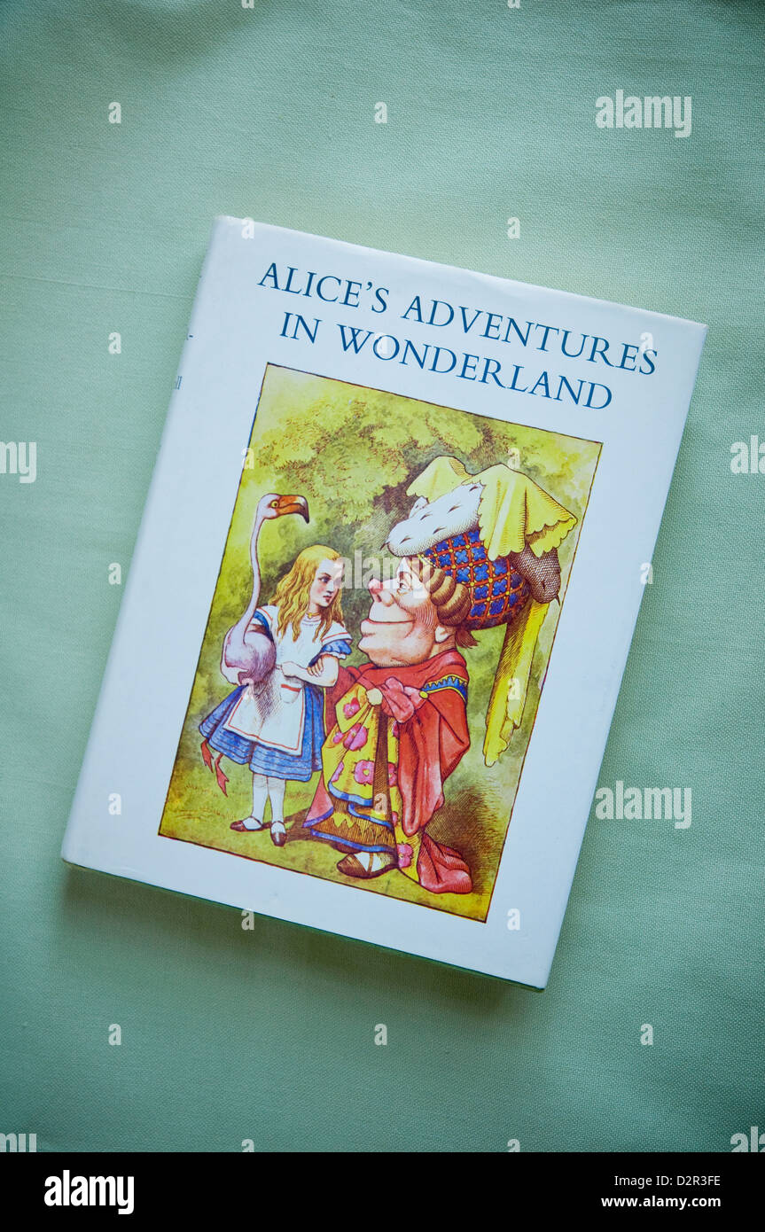 Alice's Adventures in Wonderland by Lewis Carroll with dust jacket illustration by Sir John Tenniel book published - Stock Image
