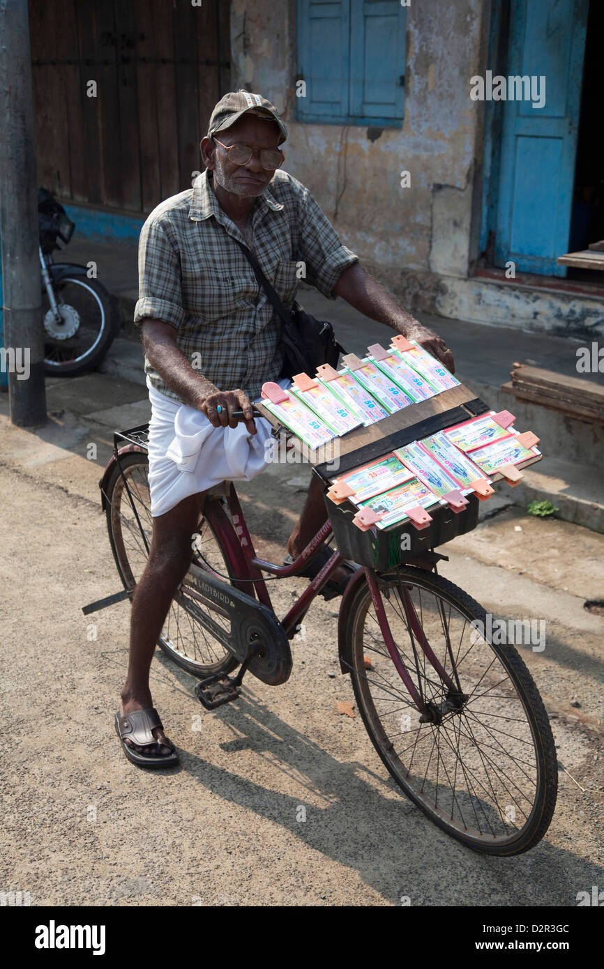 A lottery ticket seller on his bicycle in Kochi (Cochin), Kerala, India, Asia - Stock Image