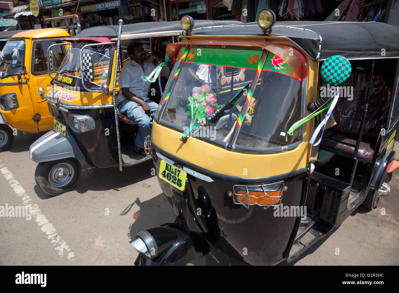 Auto rickshaws for hire in the street in Munnar, Kerala, India, Asia - Stock Image