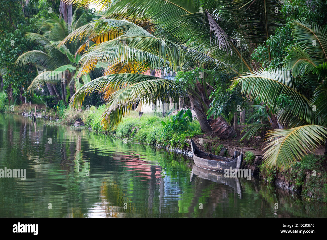 Traditional boat moored on the still water of the Kerala Backwaters, Kerala, India, Asia - Stock Image