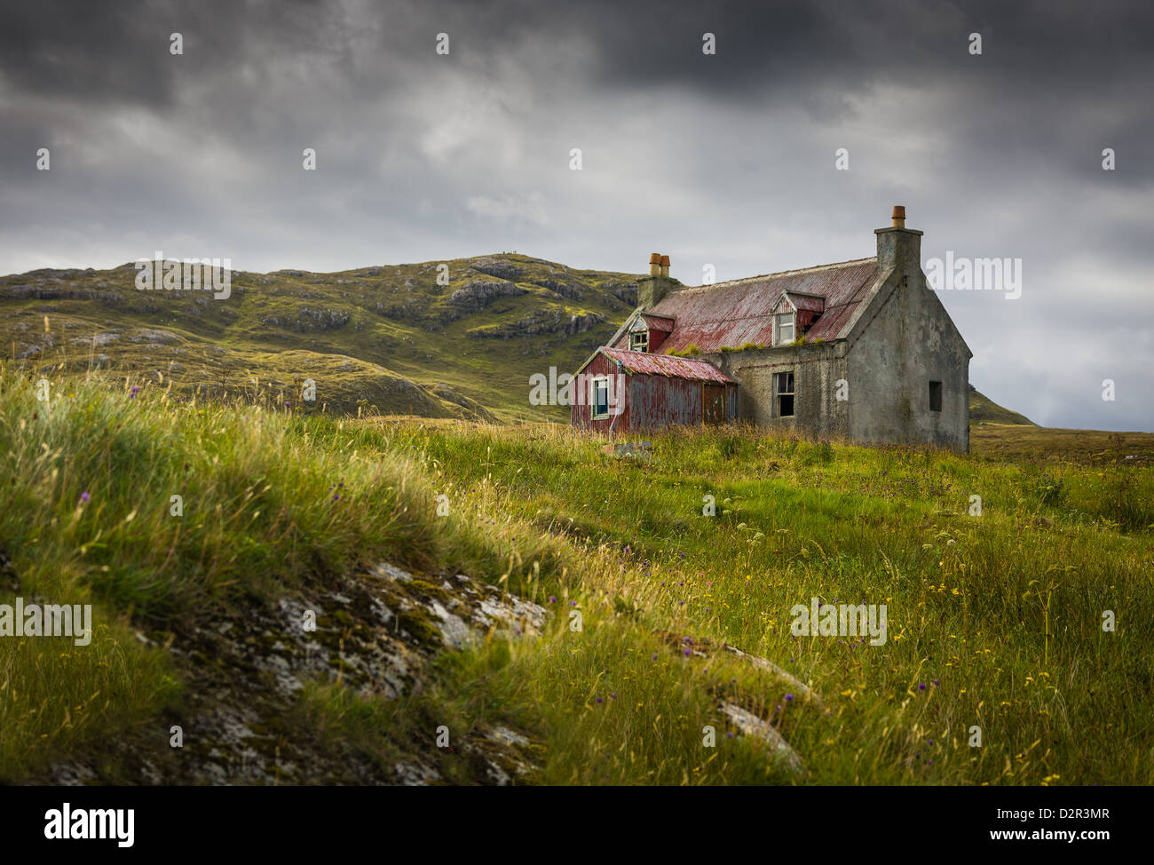 Derelict house on Eriskay in the Outer Hebrides, on a stormy day - Stock Image