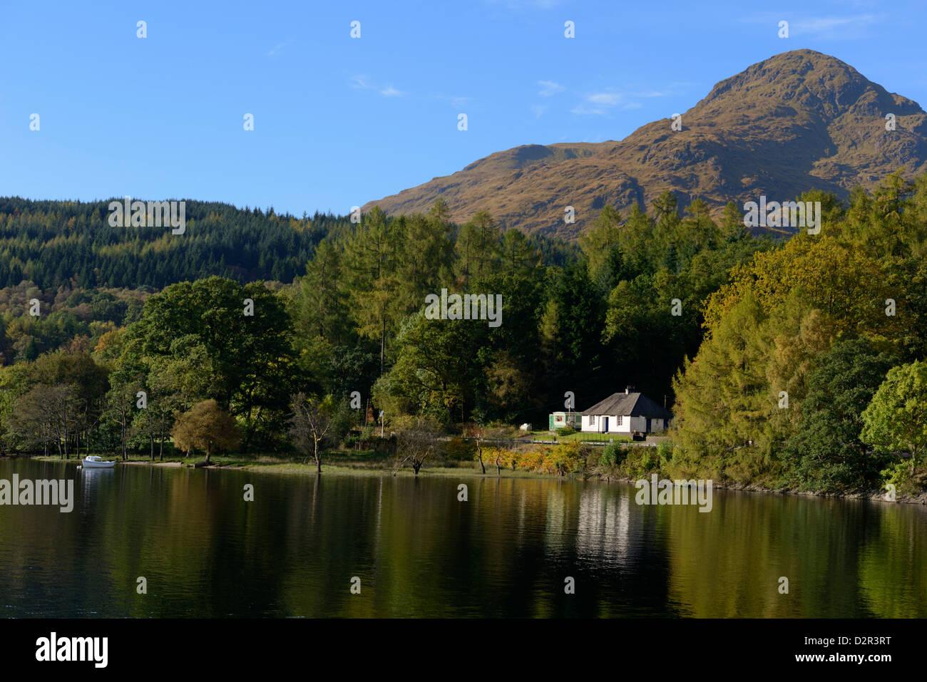 Waterside cottage, Inveruglas, Loch Lomond, Stirling, Scotland, United Kingdom, Europe - Stock Image