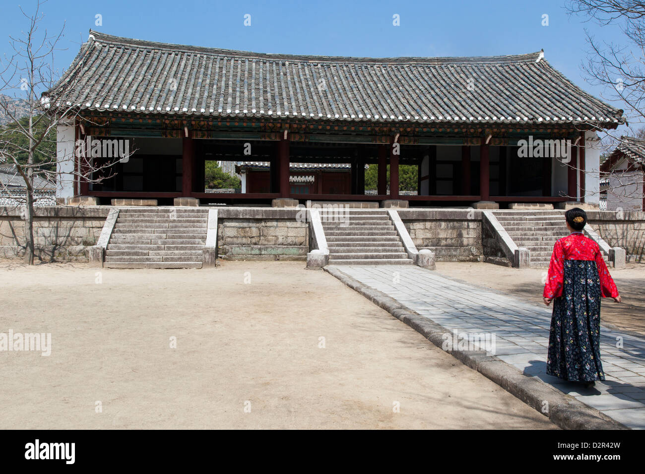Woman in traditional dress at King Wang Kon's Mausoleum, Kaesong City, North Korea - Stock Image