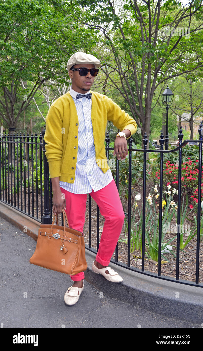 Portrait of a stylish young man in pink pants at Washington Square Park in Greenwich Village, New York City. - Stock Image